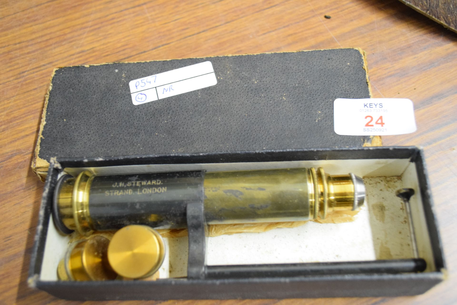 J H Steward, Strand, London, small brass travelling microscope and lenses, 16cm high