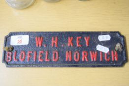 Small iron plaque for W H Key, Blofield, Norwich