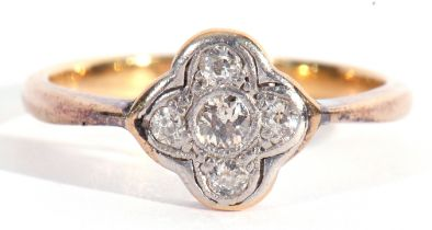 Antique five stone diamond ring, the shield shaped plaque centring an old cut diamond in a