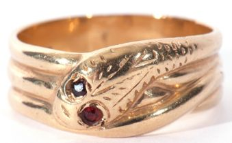 9ct gold serpent ring, the chased head with two small garnet set eyes resting on a coiled body