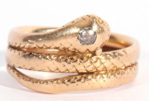 Early 20th century 18ct gold and diamond serpent ring, the head set with a small old cut diamond,