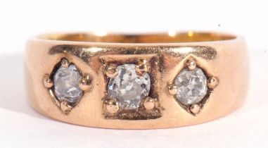 Antique three stone diamond ring featuring three graduated old cut diamonds, each individually in