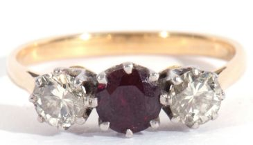 Ruby and diamond three-stone ring, the round faceted ruby flanked by two round brilliant cut