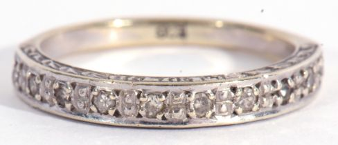 Diamond set half eternity ring featuring ten small single cut diamonds, stamped 9ct, size L