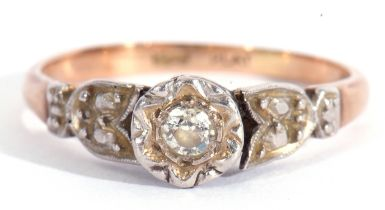 Diamond single stone ring featuring a small old cut diamond in illusion setting raised between