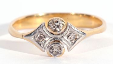 Precious metal four stone diamond shield shape ring featuring two small old cut diamonds in bezel