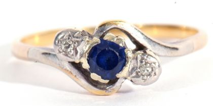 Sapphire and diamond cross over ring, the round shape faceted sapphire between two small single
