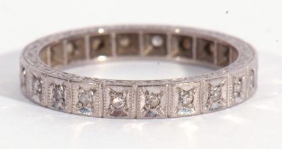 Precious metal and diamond full eternity ring with 22 small single cut diamonds, both edges with