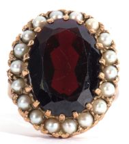 Modern 9ct gold dress ring, a large red paste faceted stone, 18 x 12mm, within a seed pearl