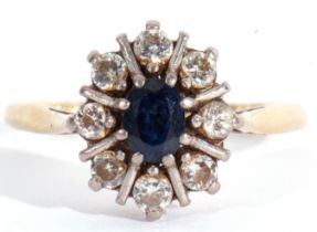 Sapphire and diamond cluster ring, the oval faceted sapphire 6 x 4mm within a round brilliant cut