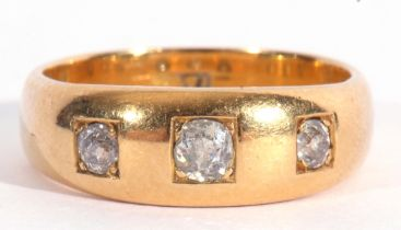 Antique three-stone diamond ring featuring three old cut diamonds, each in engraved square settings,