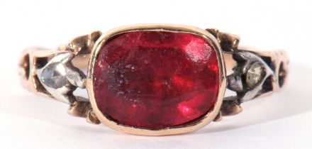Antique paste set ring, the foil backed red stone framed in an engraved enclosed setting between