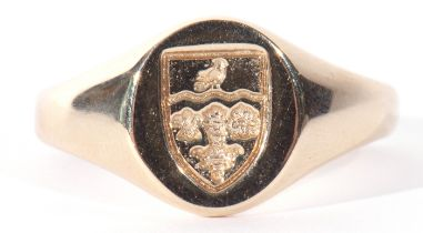 9ct gold shield shaped signet ring, the oval panel chased and engraved with a shield raised