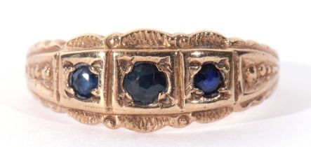 9ct gold three stone sapphire ring featuring three graduated round shaped small sapphires, each