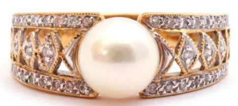 Pearl and diamond dress ring, the central collar set cultured pearl raised between pierced diamond