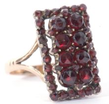 Vintage garnet ring of rectangular shape, 18 x 10mm and decorated with two tiers of graduated