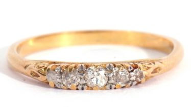 Five stone diamond ring, a design with five graduated small mixed cut diamonds, all in a carved