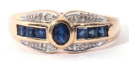 A modern sapphire and diamond ring, centring an oval bezel-set sapphire