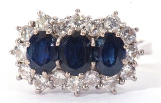 Precious metal, sapphire and diamond cluster ring, having three oval shaped sapphires within a