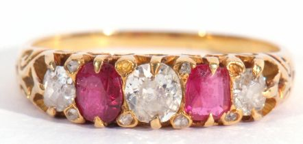 Antique diamond and ruby five stone ring, alternate set with graduated old cut diamonds and two oval