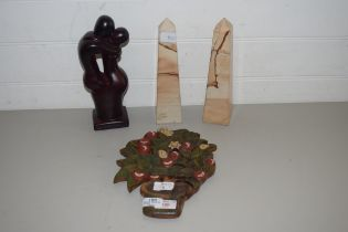 PAIR OF MODERN POLISHED STONE OBELISKS, HARDWOOD FRUIT DECORATED WALL PLAQUE AND A POLISHED WOODEN