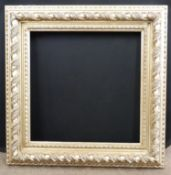 A modern bevelled edged rectangular picture frame, approx 25 x 34ins