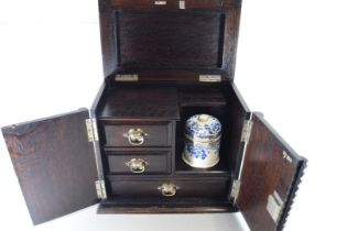 EARLY 20TH CENTURY DARK OAK SMOKERS CABINET WITH FITTED INTERIOR