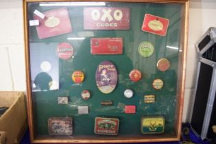 LARGE FRAME CONTAINING VARIOUS VINTAGE TOBACCO AND OTHER TINS