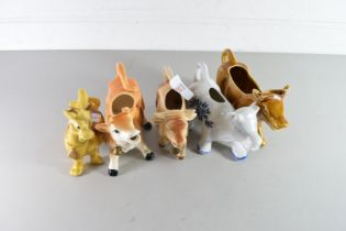 COLLECTION OF FOUR MODERN COW CREAMERS AND A FURTHER COW ORNAMENTS (5)