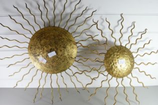 TWO METAL WALL DECORATIONS FORMED AS SUNS