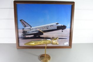 DESK ORNAMENT MODELLED AS A ROCKET, TOGETHER WITH A FRAMED PHOTOGRAPH OF A NASA SPACESHIP
