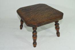 Late 19th century oak four legged milking stool