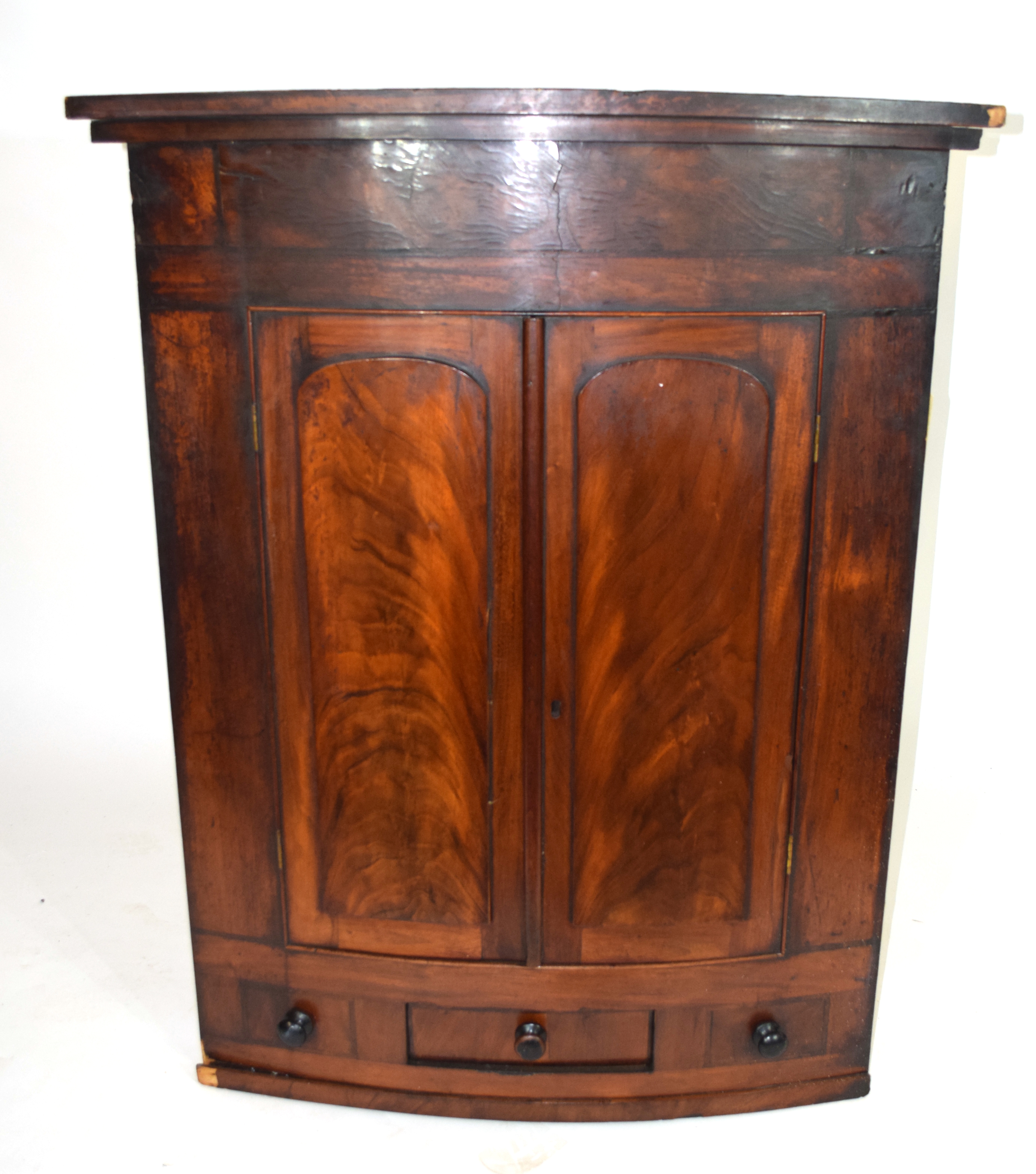 19th century mahogany corner cabinet of large proportions, the bow front body with two panelled