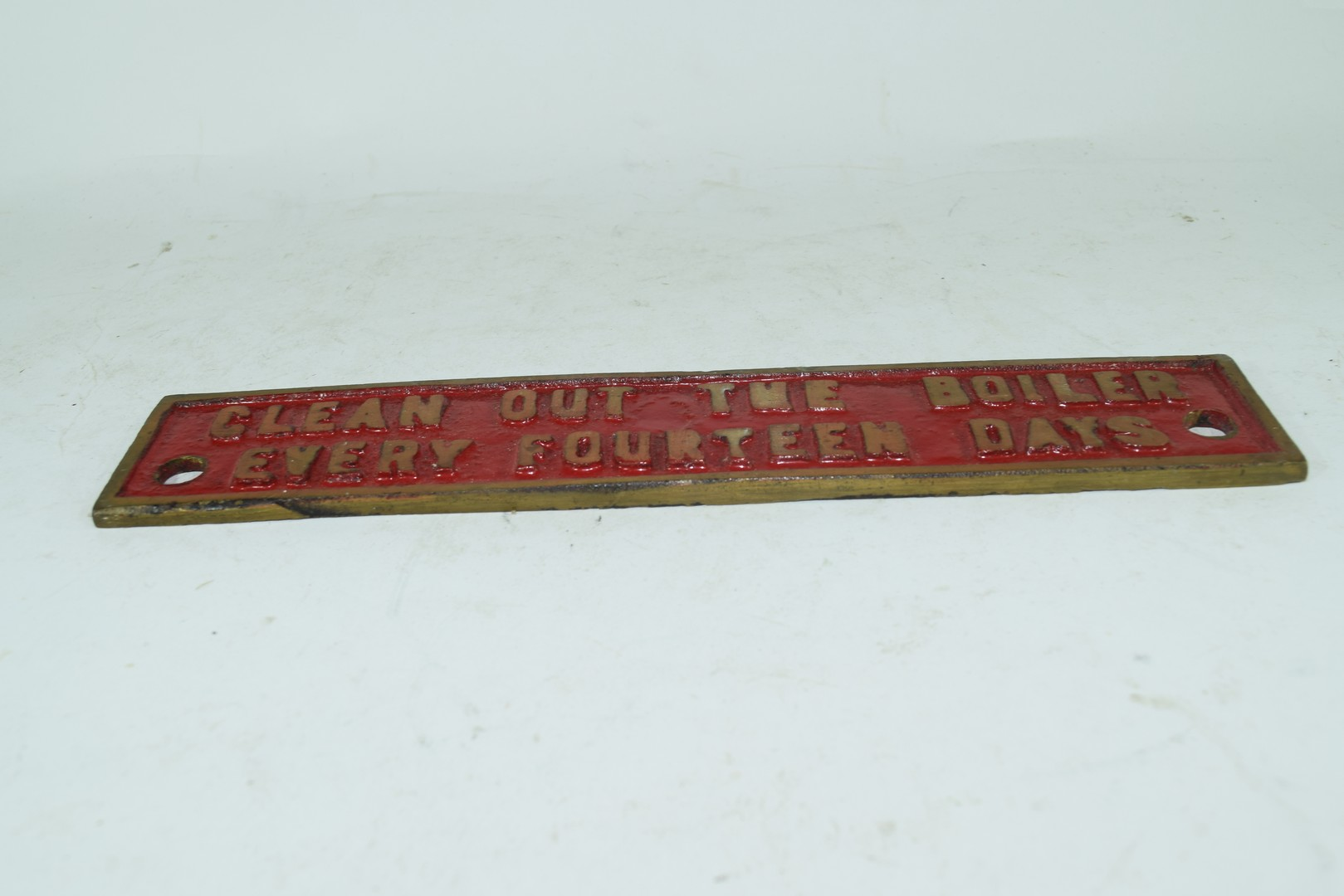 """Small cast brass plaque marked """"Clean out the boiler every 14 days"""" - Image 2 of 3"""
