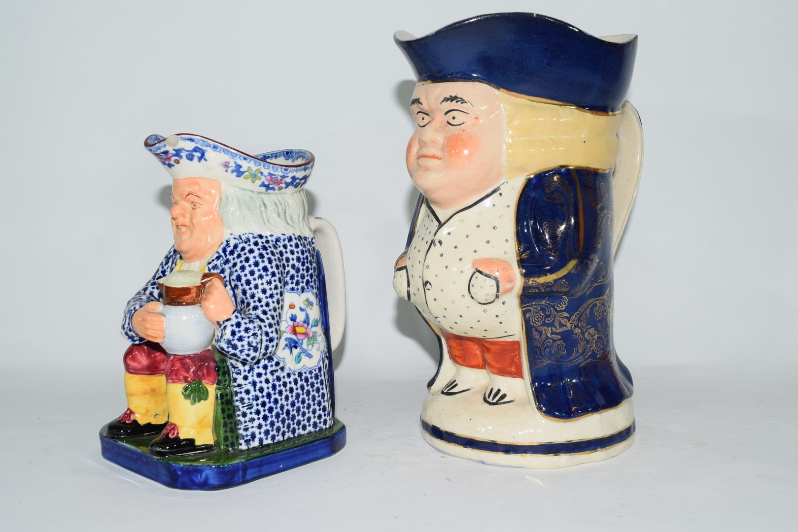 Two English pottery Staffordshire type Toby jugs