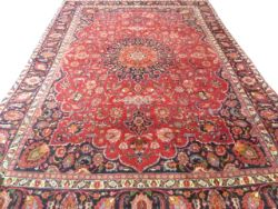 Large red ground Persian Mashad Carpet, mutlicoloured with traditional design 388cm x 270cm approx