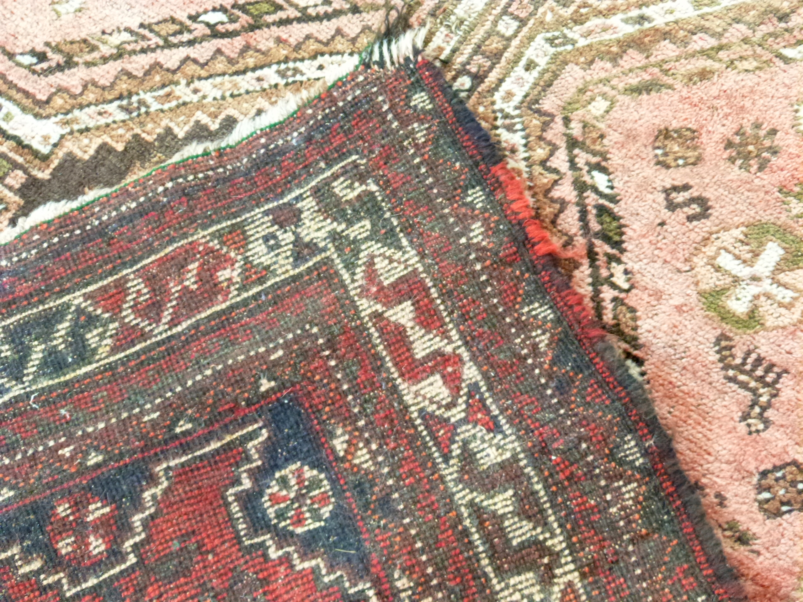 Caucasian wool carpet with three large lozenges to centre, in faded beige, red and pink, 173 x - Image 6 of 6