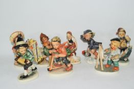 Collection of eight Friedel of Bavaria models of children doing various activities including one