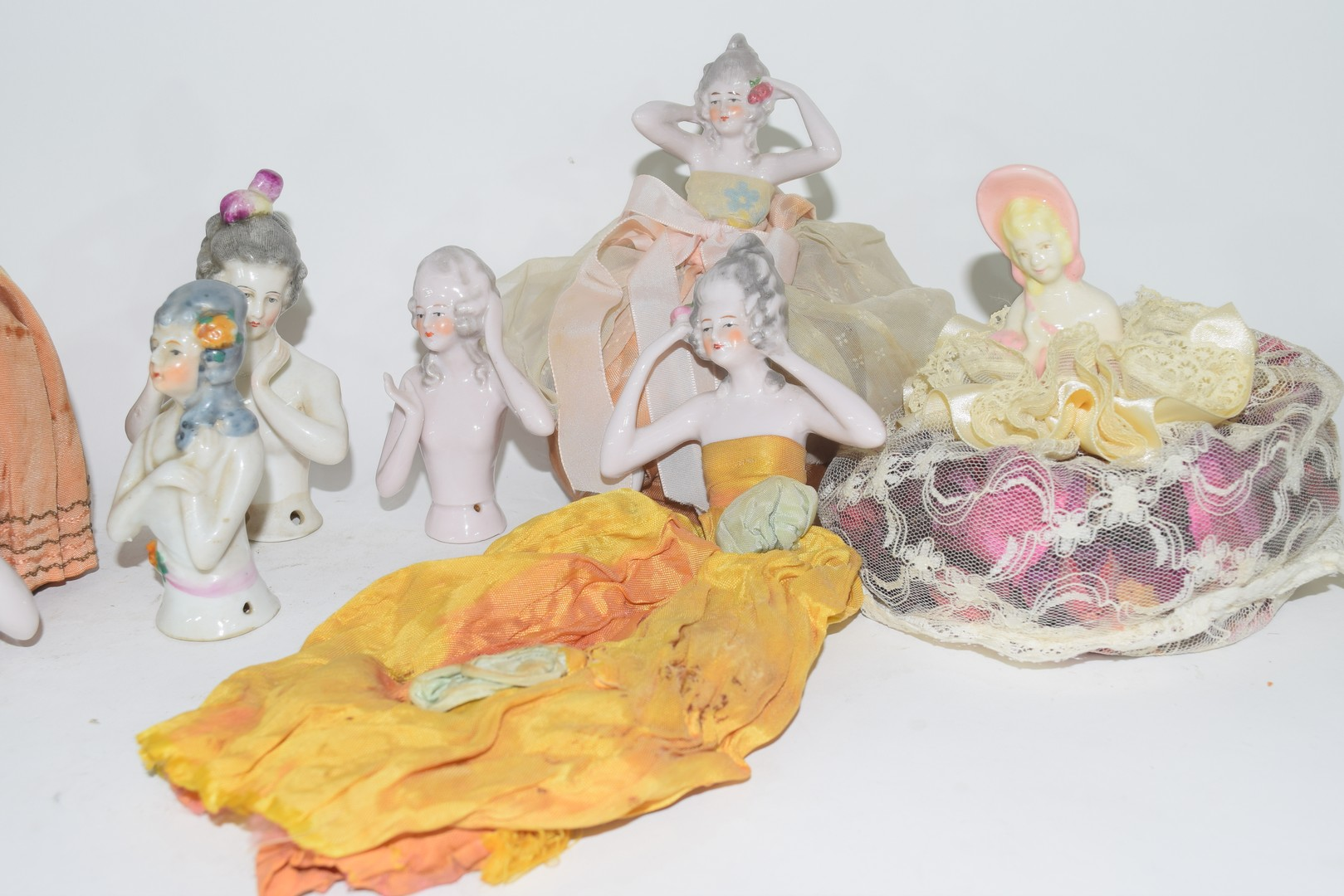 A collection of various continental porcelain pin cushion dolls to include examples in dress, a - Image 2 of 4