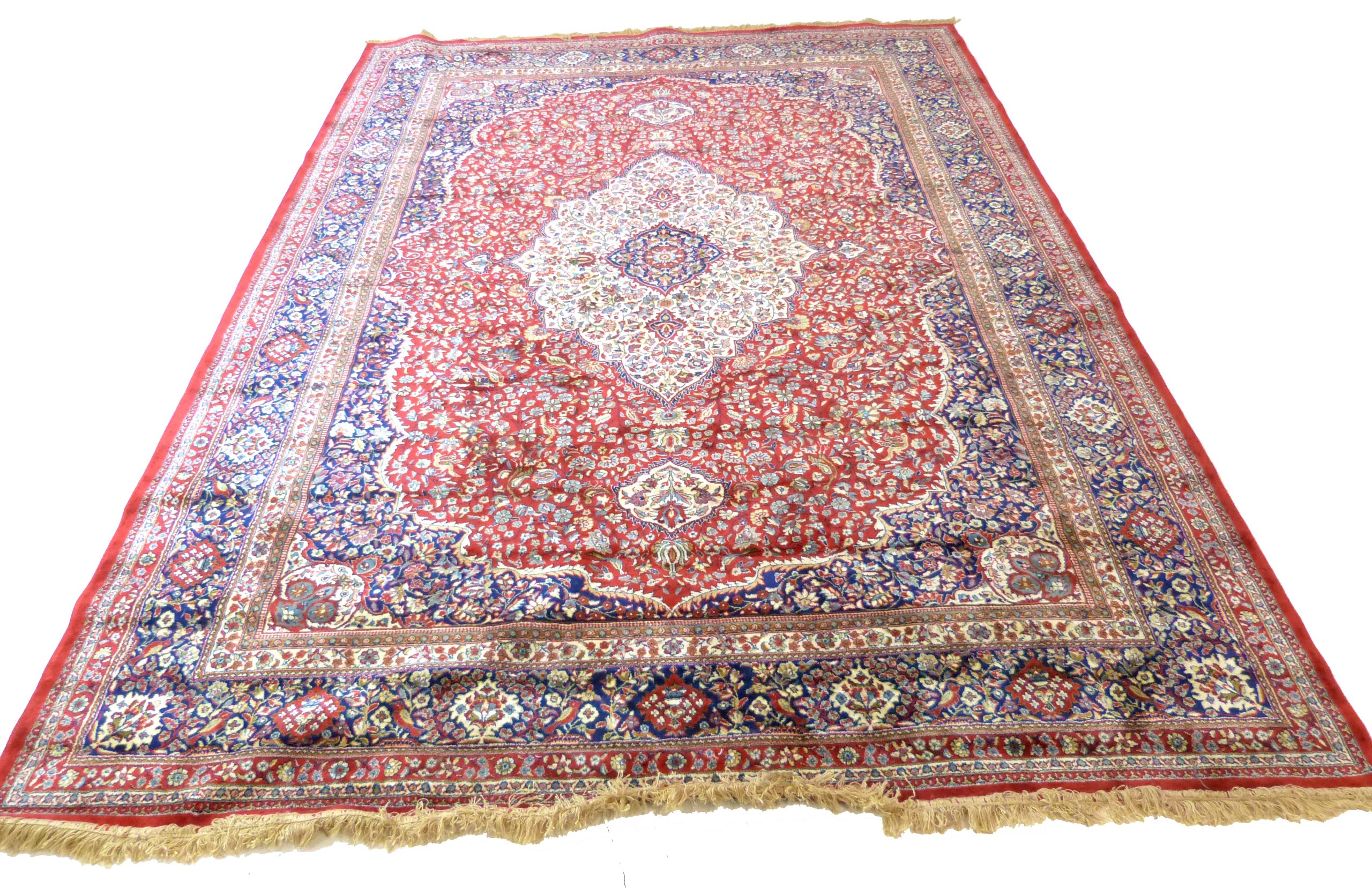 Large red ground full-pile Kashmir Carpet, floral medallion design, 340cm x 230 cm approx