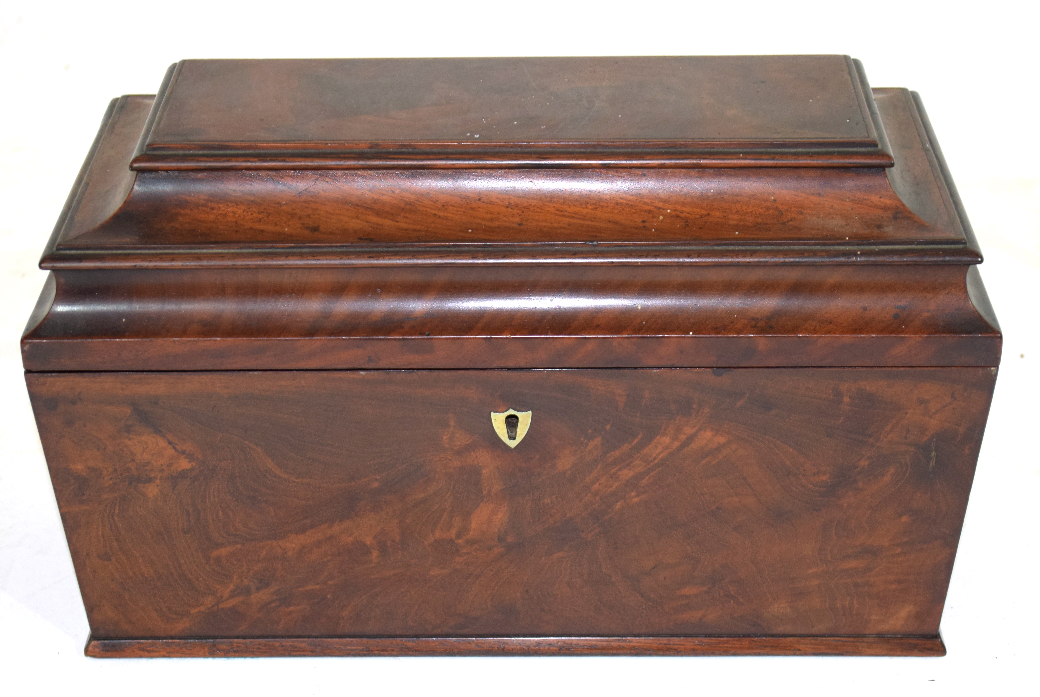 Georgian mahogany sarcophagus formed tea caddy, the hinged lid opening to an interior with two