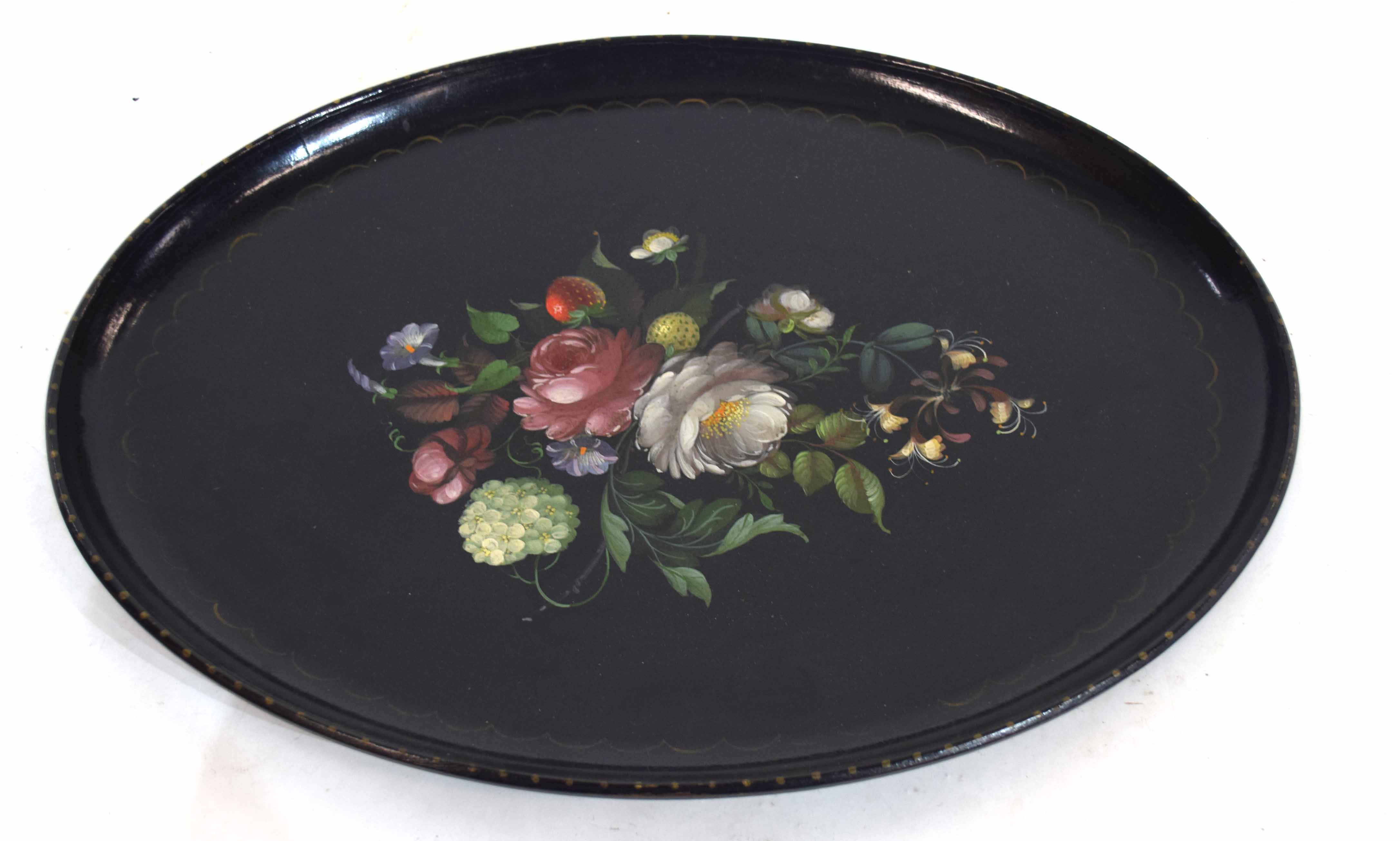 Papier mache type tray, the centre decorated with flowers and fruit within a loop border, 52cm