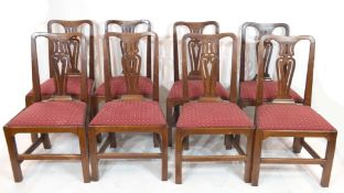 A set of eight 19th century mahogany dining chairs with pierced splat backs and red upholstered push