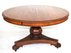 Victorian mahogany pedestal dining table, the circular top over a bulbous pedestal raised on a