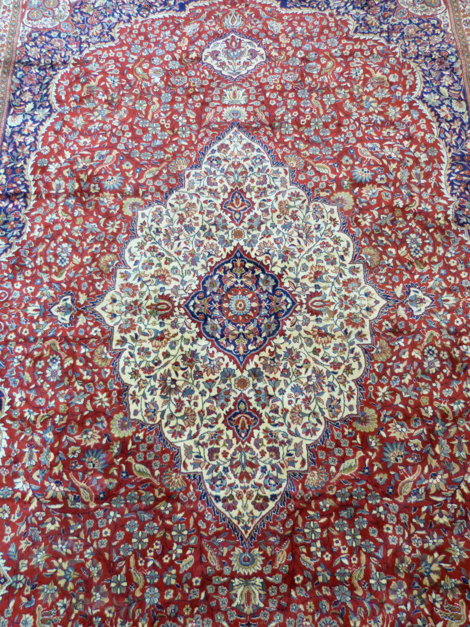 Large red ground full-pile Kashmir Carpet, floral medallion design, 340cm x 230 cm approx - Image 5 of 8