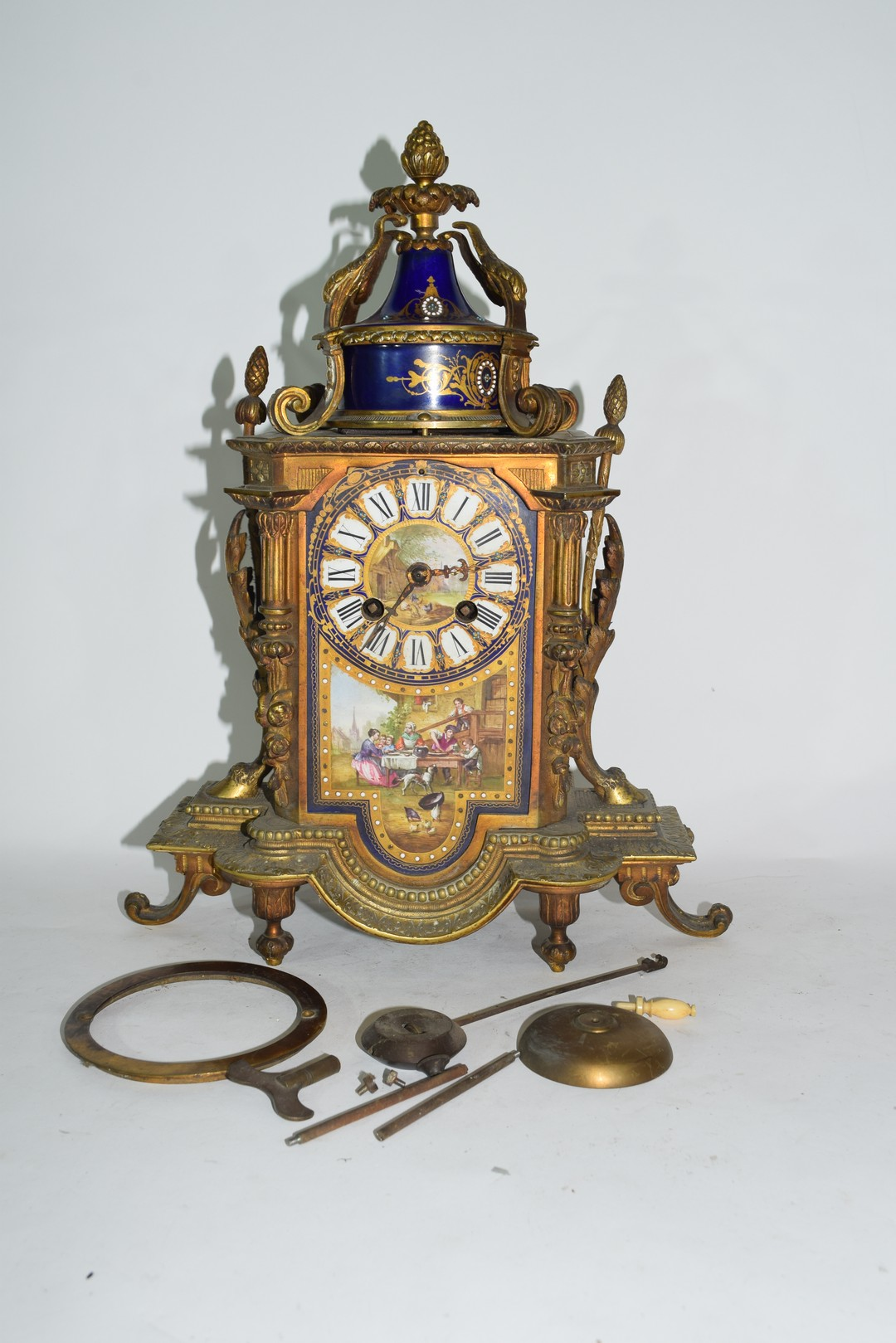 19th century French gilt metal clock with Sevres type porcelain panels