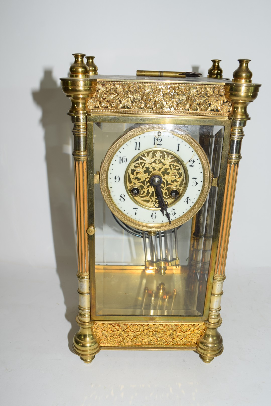 French gilt brass and four glass mounted clock
