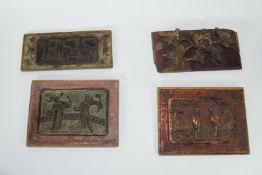 Group of seven Oriental wooden panels