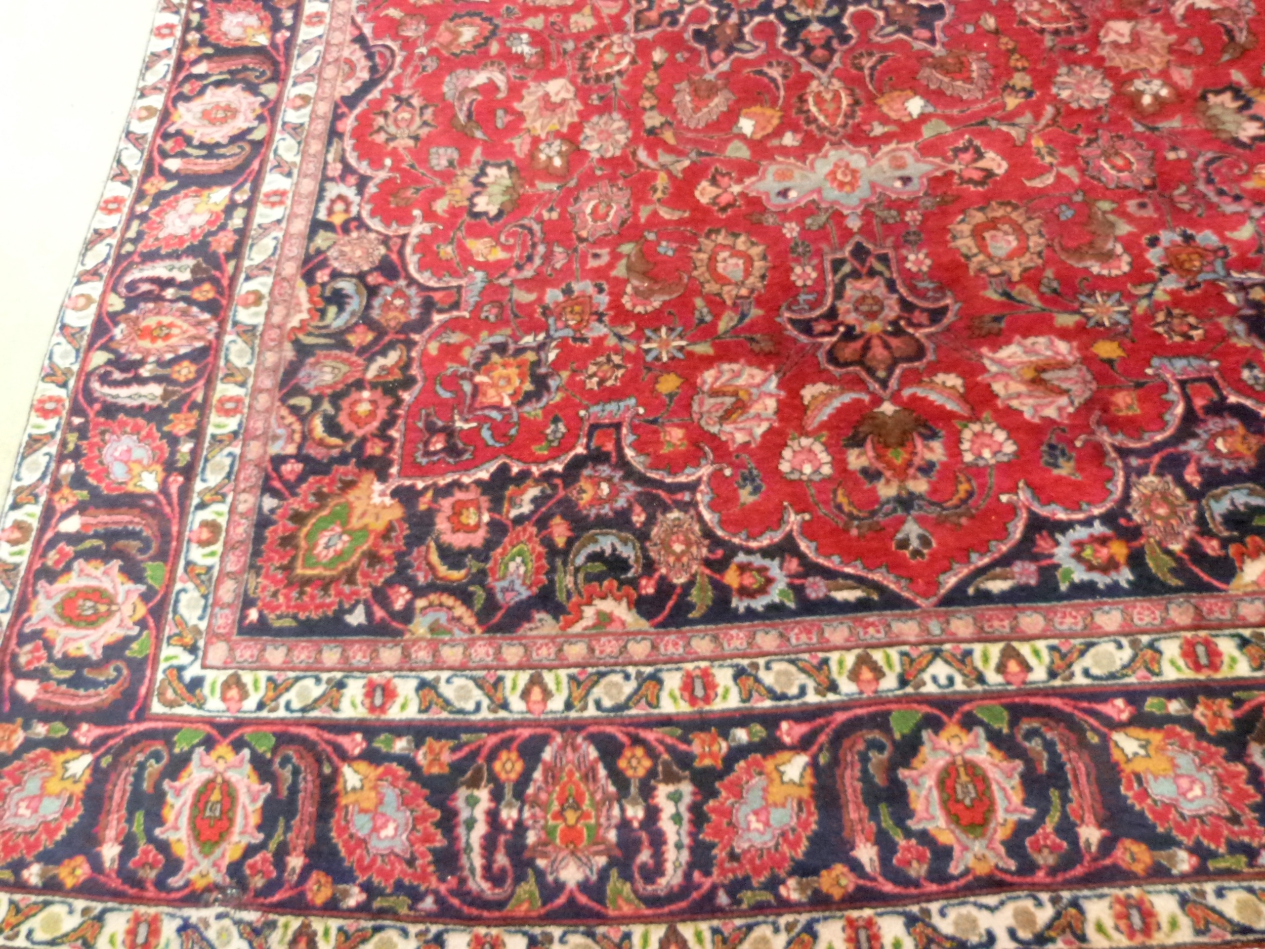 Large red ground Persian Mashad Carpet, mutlicoloured with traditional design 388cm x 270cm approx - Image 2 of 7
