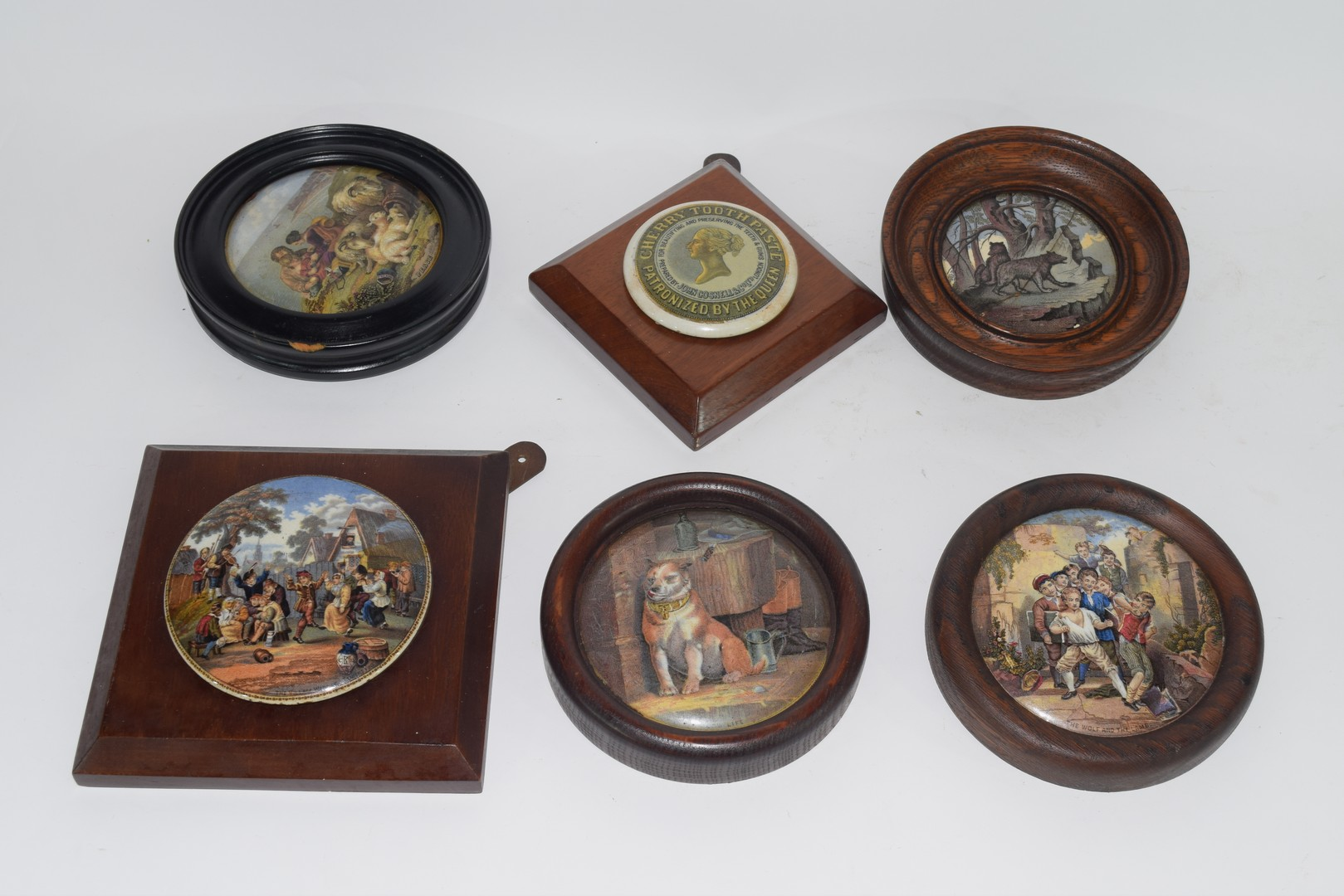 Group of pot lids on wooden mounts